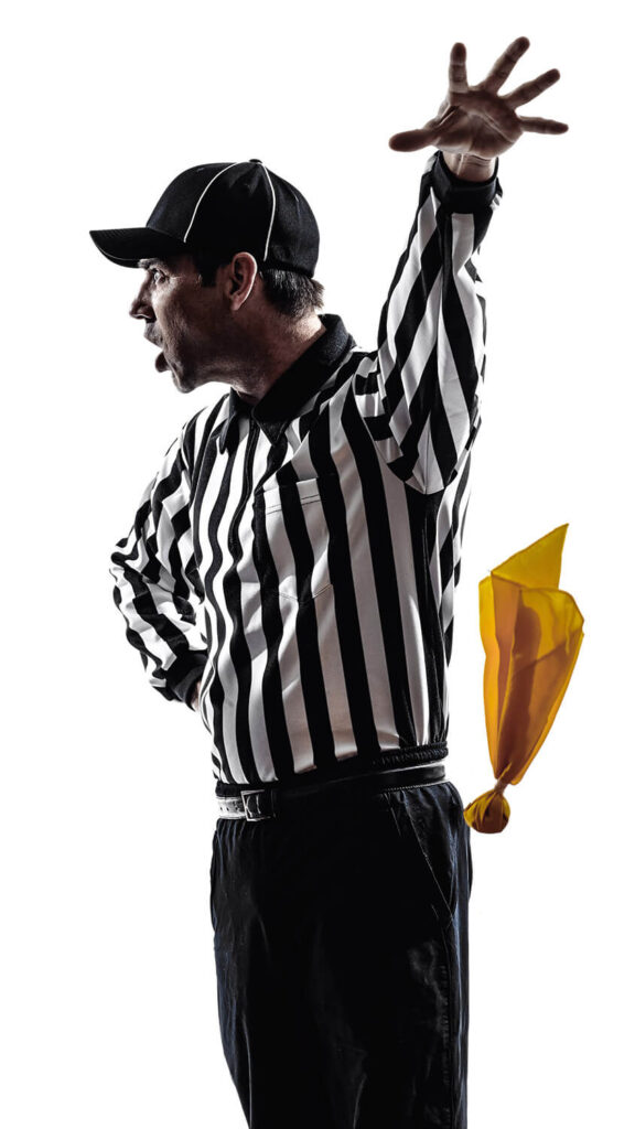 Referee throwing yellow penalty flag